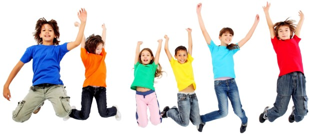 Jumping kids, dressed colorful. Representing happiness and fun.
